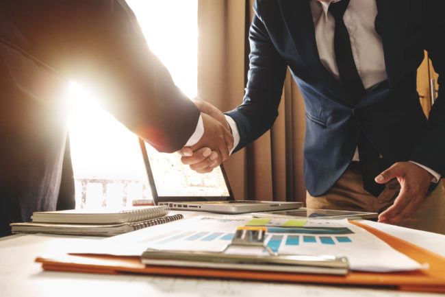 Business people shaking hands and building relationships